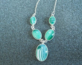 Green and white sardonyx 5 stone necklace in sterling silver bezels and chains.