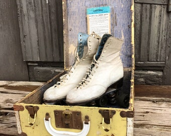 Vintage white leather rollerskates and skate case - yellow trunk