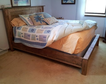Bed with low foot board