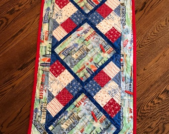 Handmade quilted table runner with a beach theme ...summery feel in blues with red accents
