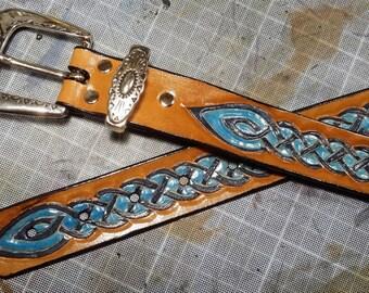 Celtic braid pattern embossed leather belt.
