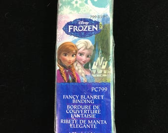 """Fancy Blanket Binding / Disney Frozen / 4.75 yard / folded 2"""" + 1.75"""" / Elsa, Anna character cameos on green background with snowflakes"""