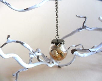 Necklace with glass ball filled with jasmine flowers
