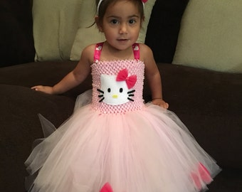 Hello Kitty Inspried Tutu Dress Plus Matching Headband! 12-24 Months & 2-3T Ready To Ship! 10% Off Entire Store! Use Coupon Code NEW10.