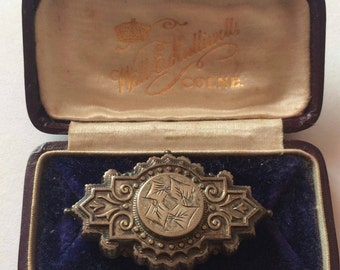 Antique silver tone art decco brooch in original vintage leather box in great condition