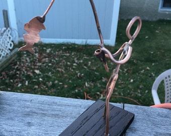Copper Art Figurine of a fisherman