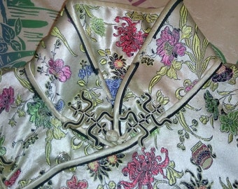 1950 satin dress of Asian style with zipper floral maneuver.