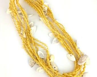 Hand spun naturally dyed vegan seacell spiral plied art yarn with seashells for knitting crochet weaving UK