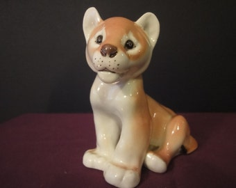 Lomonosov /ussr  Lion cub in standing position in mint condition height = 11cm