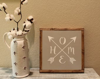 home {with arrows} wood sign.