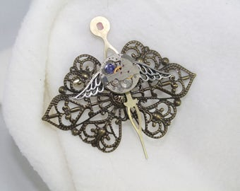 Steampunk filligree and watch movement brooch