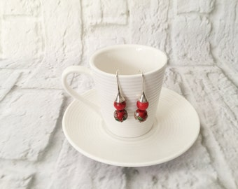 Sophisticated feminine silver earrings with lipstick red beads.