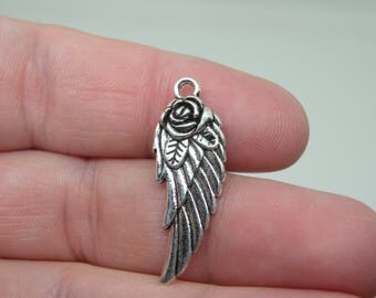 15 Silver Tone Angel Wing with a Rose Charms. B-009