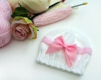Baby Girl beanie style hat with added polka dot ribbon bow.