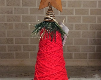 Red yarn Christmas tree-cardboard spool-original yarn-butterscotch metal star-vintage buttons-red-white-blue-gingham fabric-bow-greenery
