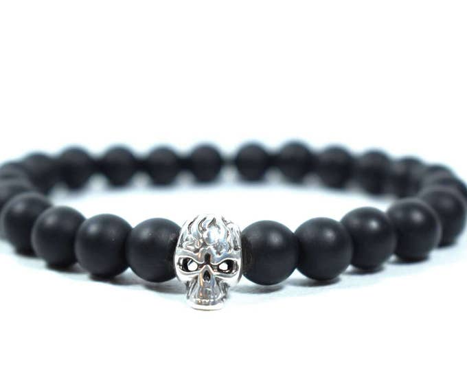 Men's Bracelet with Matte Black Onyx and a Silver tone metal Skull bead.