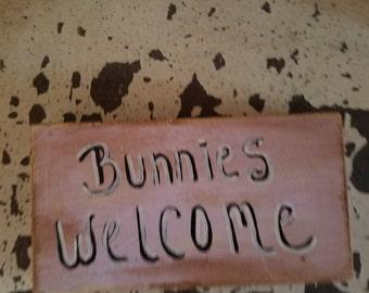 Bunnies welcome wooden sign