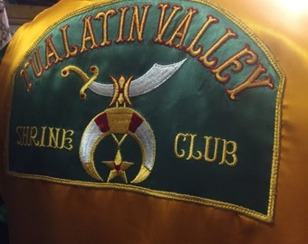 Neat-o! A satin shrine club top of the 1950s