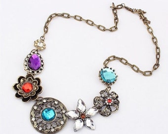 Beautiful vintage necklace with different color stones to go with any outfit. You can dress it up or even where it with short set.