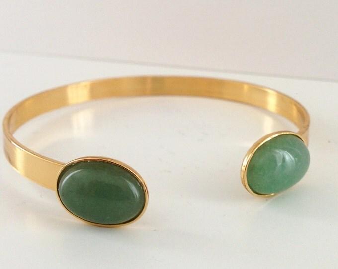 Golden cuff bracelet and aventurine gemstone