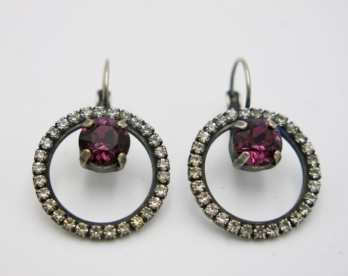 Amethyst purple Swarovski geometric hoop crystal dangle earrings surrounded by a halo of crystals for a trendy ultra-modern everyday look.