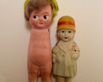 pair of small bisque flapper dolls 1920's