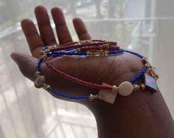 Red, Blue and Gold waistbeads with Brown Mother of Pearl and White Seashells.
