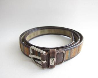Yves Saint Laurent, belt leather and fabrics, 1980. Signed.