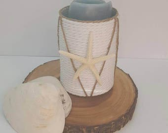 Nautical pillar candle holder.