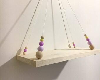 Shelf swing for purple and yellow nursery
