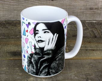 Bjork Sugarcubes MUG keeps your coffee HOT well maybe keeps your coffee contained is more accurate but its nostalgia and 80s and you want it