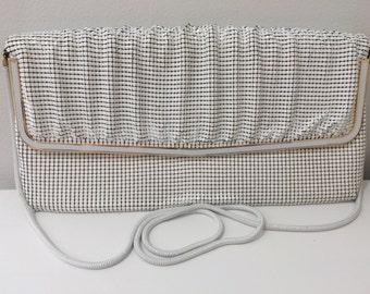 White Glomesh brand handbag