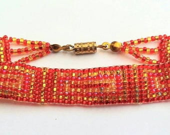 Red and gold seed bead friendship stlye bracelet
