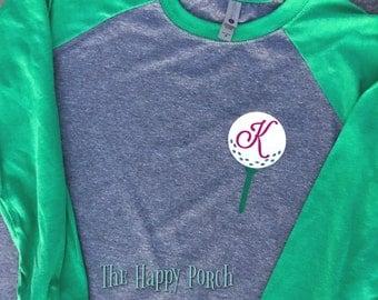 Golf ball, tee, monogram shirt