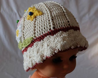 Crochet hat with flower and butterflies