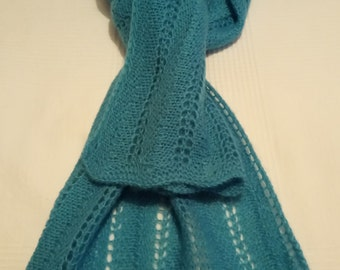 A Hand Knitted Turquoise Winter Shawl For Women