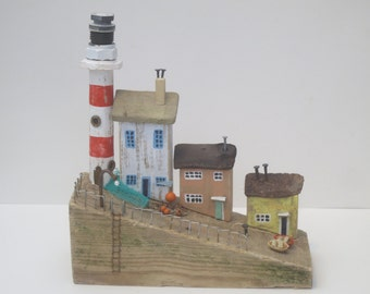 Slipway with cottages and lighthouse.