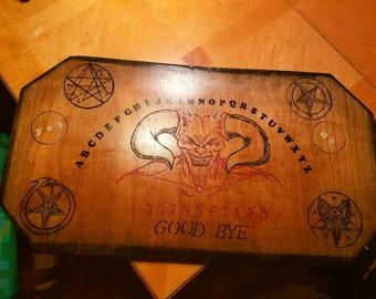 Satanic, demonic Ouija's talking board with skull planchette. Hand crafted and burnt in. One of a kind. Artist signed