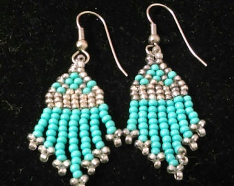 Southwest style turquoise and silver beaded earrings.