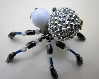 Spider beaded  white,black.silver,blue on legs..