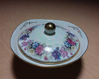 Pretty iridescent, pastel colors, flowers, and gold trim bowl. I believe that the bowl was made by Royal Sealy.  Estate found. Lidded bowl.