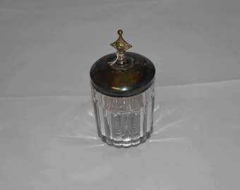 Antique glass vaseline jar with silver lid