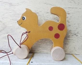 Wood pull along toy Cat in Ocher, hand cut hand-painted wooden toy for kids toddlers, cheerful personalized wood toy cat on wheels, push toy