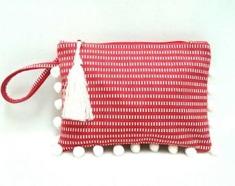 Red and white boho chic wristlet clutch with white pom poms. Boho summer pochette. Red clutch bag. Beach pom pom purse.