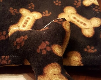 dog paw and bone blanket and squeaker toy