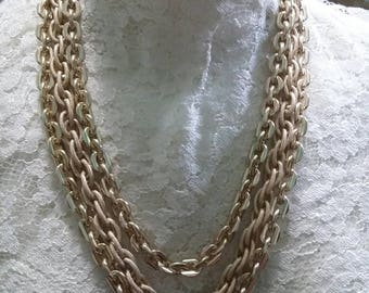 Triple gold tone chain with fancy slide clasp necklace
