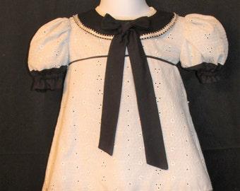 Ivory Eyelet dress trimmed in black
