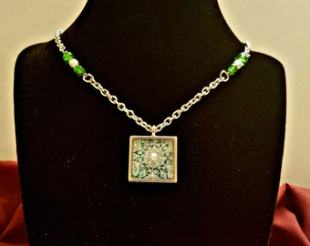 Winter Wonderland Necklace; snowflake pendant with green bead on silver chain