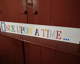 "Reading nook sign: ""Once upon a time..."""