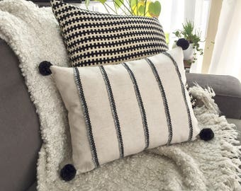 Striped Lumbar Throw Pillow w/ Fringe Trim and Pom Poms, Natural/Black